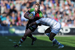 Joe Marler (Harlequins) is tackled by Marland Yarde (London Irish) - Photo mandatory by-line: Patrick Khachfe/JMP - Tel: Mobile: 07966 386802 29/03/2014 - SPORT - RUGBY UNION - The Twickenham Stoop, London - Harlequins v London Irish - Aviva Premiership.