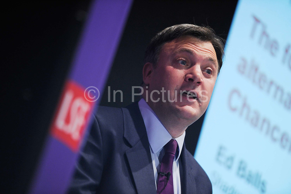 Britain's Shadow Chancellor Ed Balls speaks during his lecture at the London School of Economics. Balls urged Chancellor George Osborne on Thursday to temporarily reverse this year's rise in value-added tax to boost stuttering economic growth.