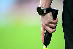 Detail of a Tag Heuer watch on the wrist of a linesman