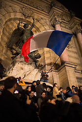 """People holding a french on the place saint michel in behind a statue of Virgin Mary during an evening of prayer and songs organized by Catholics community the day after Notre Dame Cathedral blaze with a march organized from Saint-Sulpice church to Saint Michel and finally next to Notre Dame Cathedral in Paris early on April 16 the day after the beginning of the fire , 2019. A huge fire that devastated Notre-Dame Cathedral is """"under control"""", the Paris fire brigade said early on April 16 after firefighters spent hours battling the flames. Photo by Raphael Lafargue/ABACAPRESS.COM"""