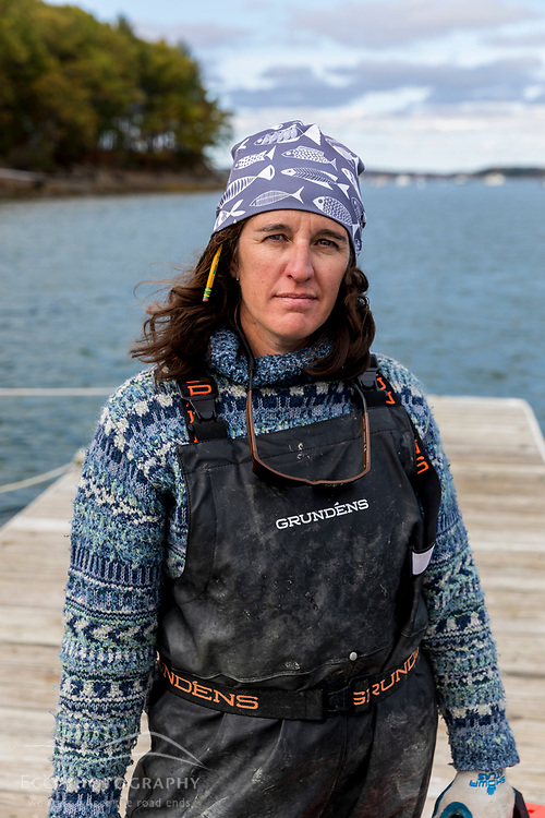 The Nature Conservancy's Alix Laferriere on the dock at the  the Supporting Oyster Aquaculture and Restoration (SOAR) program on the shores of Great Bay in Durham, New Hampshire.