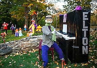 Elton John is in the house with quite a cast of charactors in the audience at the Barros' Liberty Hill Scarecrow display.  (Karen Bobotas/for the Laconia Daily Sun)