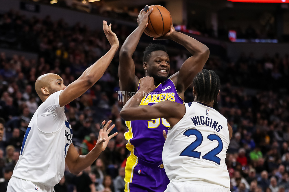 Feb 15, 2018; Minneapolis, MN, USA; Los Angeles Lakers forward Julius Randle (30) attempts to pass around Minnesota Timberwolves forward Taj Gibson (67) and forward Andrew Wiggins (22) during the second quarter at Target Center. Mandatory Credit: Brace Hemmelgarn-USA TODAY Sports