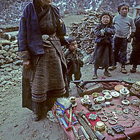 NEPAL, HIMALAYA, Sherpa woman selling souvenirs to trekkers hiking to Mount Everest base camp, Khumbu region.