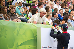 Carl Hester puts his signature - Freestyle Grand Prix Dressage - Alltech FEI World Equestrian Games™ 2014 - Normandy, France.<br /> © Hippo Foto Team - Jon Stroud<br /> 25/06/14