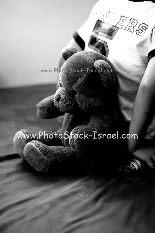 Child protecting Teddy bear behind his back a black and white illustration of violence in the family