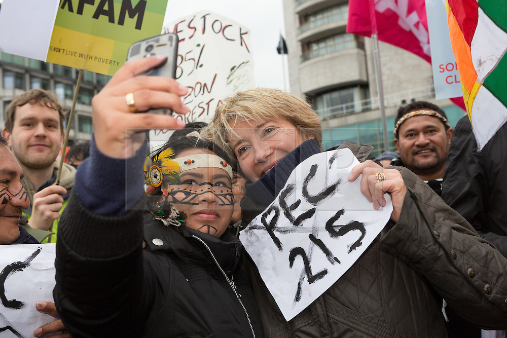 © Licensed to London News Pictures. 29/11/2015. London, UK.  EMMA THOMPSON takes a selfie with a protester taking part in the People's March for Climate, Justice and Jobs in central London. Marchers are calling for world leaders take further measures to combat climate change and environmental issues. Demonstrations are taking place around the globe today to demand United Nations action against climate change, calling on world leaders to cease political posturing and commit to a concrete international plan for people affected by climate change at the UN Paris Climate Change Summit. Photo credit : Vickie Flores/LNP