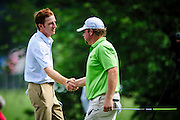 USA's Roberto Castro shakes hands with his playing partner, USA's William McGirt, at the end of his first round of the AT&T National golf tournament at Congressional Country Club in Bethesda, Maryland, USA, 27 June 2013. Castro finished with a 5-under par 66 to be the leader after the completion of the first round.