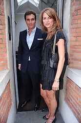 DAVID PEACOCK and his wife GABRIELLA at a private view of photographs by David Bailey entitled 'Then' held at Hamiltons, 13 Carlos Place, London W1 on 6th July 2010.