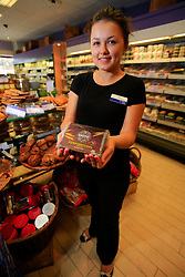 """UNITED KINGDOM WIMBLEDON 26JUN09 - Saleswoman Katherina (19) at Bailey & Sage poses for a photo with a Pumpernickel bread in Wimbledon Village, Boris Becker's new home in London. The newlyweds Boris Becker & Sharlely """"Lilly"""" Kerssenberg have recently moved into a 6-million pound property in Burghley Road, Wimbledon, London...jre/Photo by Jiri Rezac..© Jiri Rezac 2009"""
