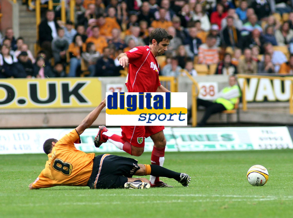 Photo: Mark Stephenson.<br /> Wolverhampton Wanderers v Norwich City. Coca Cola Championship. 22/09/2007.Wolve's Karl Hendry (no 8) gets a yellow card for this bad challenge