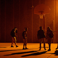 012215       Cable Hoover<br /> <br /> Jaden Dolfin, right, reaches for a rebound while playing a late-night round of basketball with his friends on the Tohatchi High School campus Thursday.