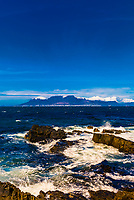 View from Robben Island, where former President of South Africa Nelson Mandela was imprisoned for 18 of the 27 years he served behind bars before the fall of apartheid, it is now a museum. Robben Island is in Table Bay. Cape Town (with Table Mountain behind) is in background, South Africa.