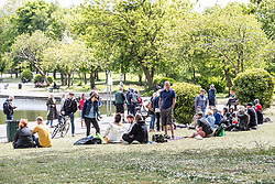 """© Licensed to London News Pictures. 16/05/2020. Manchester, UK. An anti-lockdown, """"mass gathering"""" demonstration is held in Platt Fields Park in protest at government measures to control the spread of Covid-19. A group calling itself the UK Freedom Movement has organised a series of demonstrations across the UK. Photo credit: Joel Goodman/LNP"""