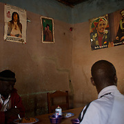 January 19, 2013 - Niono, Mali: Locals take lunch at a restaurant with Kaddafi, Bob Marley and Emperor Haile Selassiei posters displayed in the back walls. Niono village is the last government controlled location before Diabaly, a city under islamist militants control since the 14th of January.<br /> <br /> Several insurgent groups have been fighting a campaign against the Malian government for independence or greater autonomy for northern Mali, an area known as Azawad.<br /> <br /> The National Movement for the Liberation of Azawad (MNLA), an organisation fighting to turn Azawad into an independent homeland for the Tuareg people, had taken control of the region by April 2012.<br /> <br /> Consequently, the Malian government pledge to France to help the national army stop the rebellion advance towards the capital Bamako. The french troops started aerial attacks on rebel positions in the centre of the country and deployed several hundred special forces men to counter attack the advance on the ground. (Paulo Nunes dos Santos/Polaris)