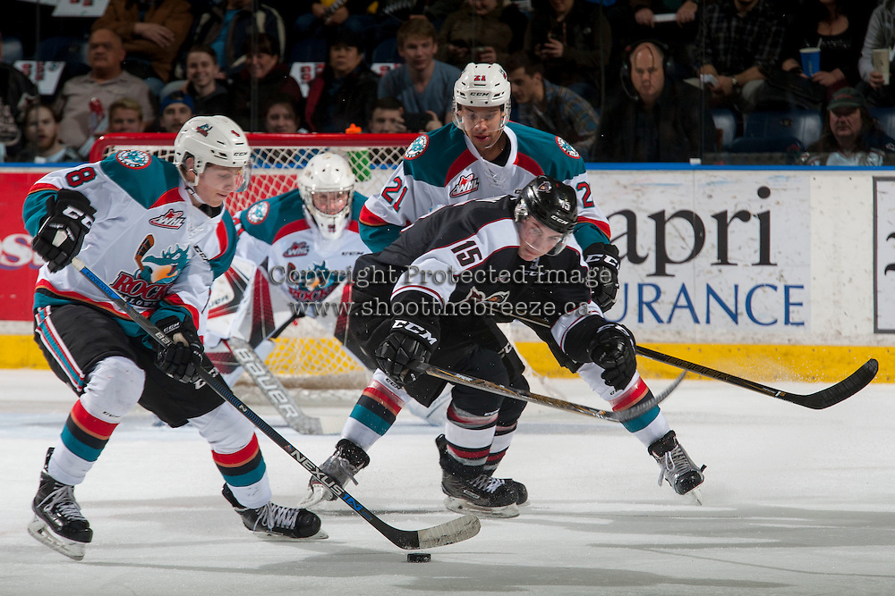 KELOWNA, CANADA - FEBRUARY 10: Devante Stephens #21 of the Kelowna Rockets back checks Owen Hardy #15 of the Vancouver Giants during first period on February 10, 2017 at Prospera Place in Kelowna, British Columbia, Canada.  (Photo by Marissa Baecker/Shoot the Breeze)  *** Local Caption ***