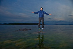 Damiam Kailek, 24, who is going onthe Thelon expidition fishes together with elder Sam Boucher and Steve Ellis, (working to protect the Thelon as a national park) in their village of Lutsel Ke' (aka Snowdrift) July 21, 2011 in the Northwest Territories of Canada. This huge reach of untrammeled country, is partially the result of the creation of the Thelon Wildlife Sanctuary. There are few places left on the planet as untouched as this.