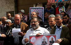 April 29, 2019 - Gaza City, Gaza Strip, Palestinian Territory - Palestinians take part in a protest to show solidarity with Palestinian Prisoners held in Israeli jails, in front of Red Cross office, in Gaza city, on April 29, 2019  (Credit Image: © Ashraf Amra/APA Images via ZUMA Wire)