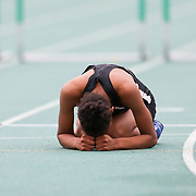 Sandusky's Myasia Matthews lies just past the finish line after finishing the girls 300 meter hurdles during the OHSAA Division I regional track and field tournament at Amherst Steele High School in Amherst, Ohio, on Friday, May 28, 2021. The field portion was postponed. THE BLADE/KURT STEISS