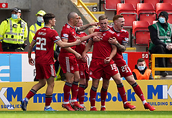 Aberdeen's Lewis Ferguson (second right) celebrates scoring their side's first goal of the game during the cinch Premiership match at Pittodrie Stadium, Aberdeen. Picture date: Sunday October 3, 2021.