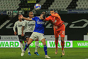 Kelle Roos of Derby County (21) punches the ball under pressure from Cardiff City midfielder Joe Ralls (8) during the EFL Sky Bet Championship match between Derby County and Cardiff City at the Pride Park, Derby, England on 28 October 2020.