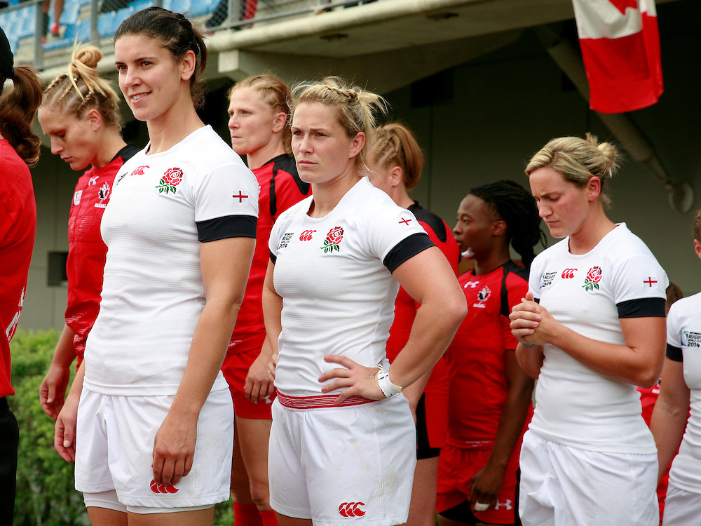 Sarah Hunter, Rachael Burford and Claire Allan line up ready to go on the pitch. England v Canada Pool A match at WRWC 2014 at Centre National de Rugby, Marcoussis, France, on 9th August 2014