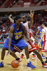 06 December 2008: Dinma Odiakosa slows down the progress of Kenneth Faried during a game where the  Illinois State University Redbirds extended their record to 9-0 with a 76-70 win over the Eagles of Morehead State on Doug Collins Court inside Redbird Arena on the campus of Illinois State University in Normal Illinois