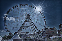 Gdansk Panoramic Wheel with Sunburst. Composite of three images taken with a Fuji X-T1 camera and Zeis-s 12 mm f/2.8 wide-angle lens (ISO 200, 12 mm, f/22, various). Raw images processed with Capture One Pro, HDR processed with Photoshop CC.