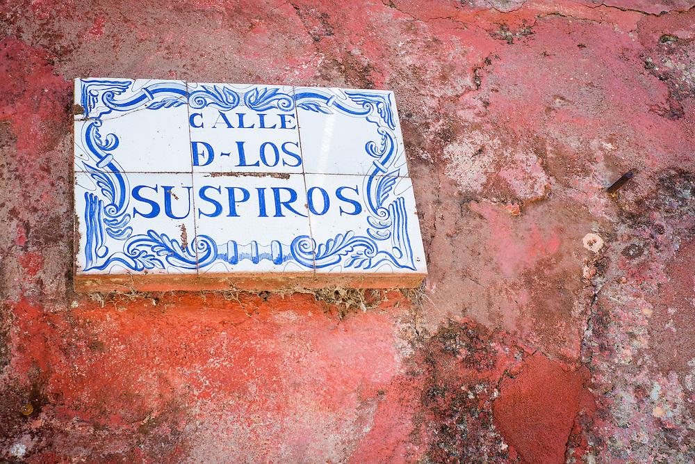 Sign over Calle de los Suspiros (Sighs Street) in Colonia del Sacramento Uruguay