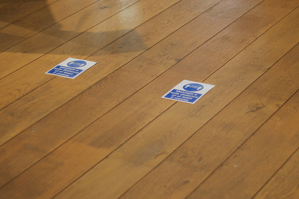 28th February, Cheltenham, England. Markings on the floor of St Gregory's Catholic Church in Cheltenham advise the congregation to practice social distancing.