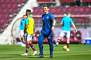Heart of Midlothian assistant manager, Lee McCulloch  is all smiles during the warm up before the SPFL Championship match between Heart of Midlothian and Inverness CT at Tynecastle Park, Edinburgh Scotland on 24 April 2021.