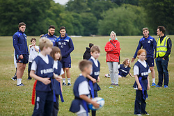 Ellis Genge, Ben Mosses and Auguy Slowik of Bristol Rugby look on as Local Junior Schools compete in a Tag Rugby Competion - Mandatory byline: Rogan Thomson/JMP - 07966 386802 - 14/07/2015 - SPORT - RUGBY UNION - Bristol, England - Durdham Downs -  Webb Ellis Cup visits Bristol as part of the 2015 Rugby World Cup Trophy Tour