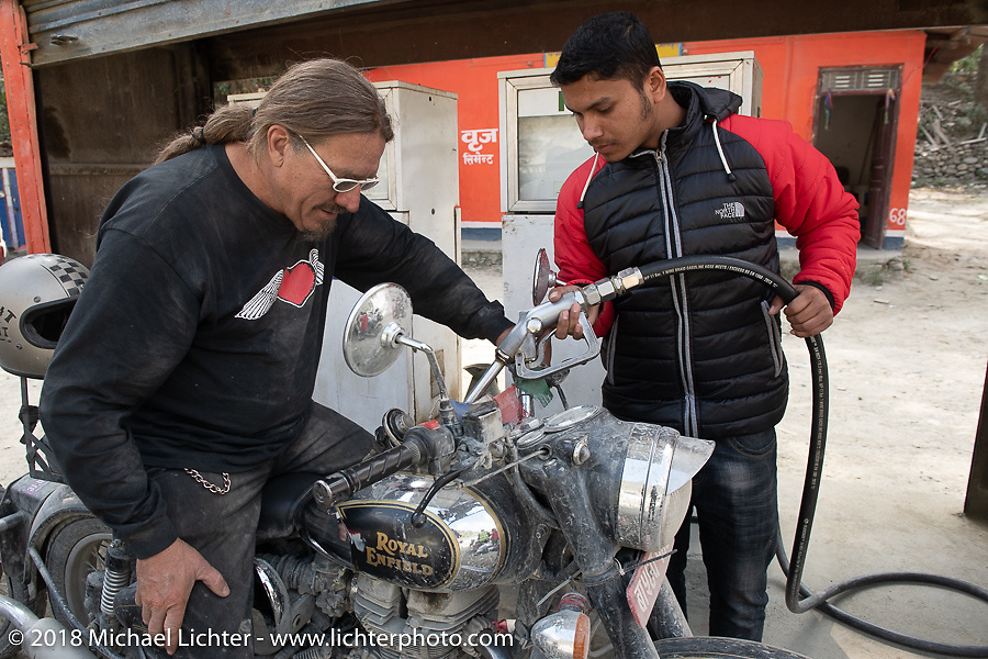 Beanre (Kevin Doebler) at a fuel stop on Day-7 of our Himalayan Heroes adventure riding from Tatopani to Pokhara, Nepal. Monday, November 12, 2018. Photography ©2018 Michael Lichter.