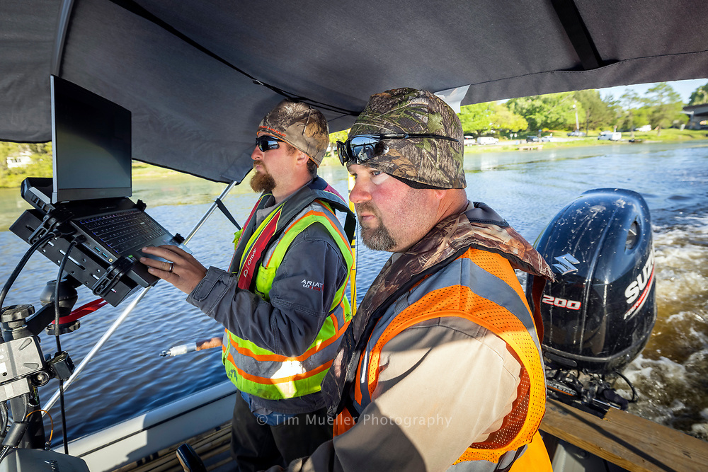Fenstermaker survey technicians Erick Kidder, left, and Richard Tauzin map the depth of City Park Lake for the next phase of the University Lakes Project plan to restore the six lakes surrounding the LSU campus.