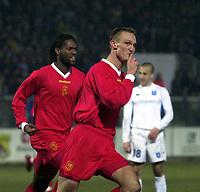Photo. Richard Lane. <br />A.J. Auxerre v Liverpool. UEFA Cup. 20/02/2003<br />Sami Hyypia celebrates his goal.