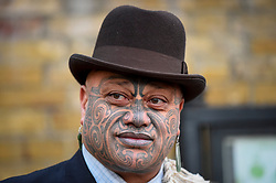 "© Licensed to London News Pictures. 24/09/2018. LONDON, UK. A member of Ngati Ranana, the London Maori Club, takes part in a ceremonial procession and blessing ceremony for the forthcoming ""Oceania"" exhibition at the Royal Academy of Arts.  The exhibition runs 29 September – 10 December 2018, representing the art of Melanesia, Micronesia and Polynesia, encompassing the vast Pacific region from New Guinea to Easter Island, Hawaii to New Zealand.  Photo credit: Stephen Chung/LNP"