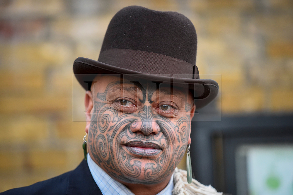 """© Licensed to London News Pictures. 24/09/2018. LONDON, UK. A member of Ngati Ranana, the London Maori Club, takes part in a ceremonial procession and blessing ceremony for the forthcoming """"Oceania"""" exhibition at the Royal Academy of Arts.  The exhibition runs 29 September – 10 December 2018, representing the art of Melanesia, Micronesia and Polynesia, encompassing the vast Pacific region from New Guinea to Easter Island, Hawaii to New Zealand.  Photo credit: Stephen Chung/LNP"""