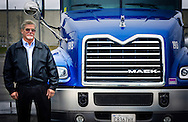 Larry Edwards, maintenance director at Highway Transport Chemical, stands beside a 2015 Mack Pinnacle truck, Dec. 17, 2014, at the company's headquarters in Knoxville, Tenn. HTC purchased 50 Pinnacles in 2014 and plan to purchase an additional 55 Pinnacles in 2015. (Photo by Carmen K. Sisson/Cloudybright)