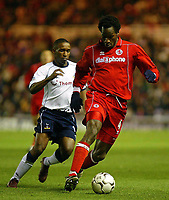 Photo. Andrew Unwin.<br /> Middlesbrough v Tottenham Hotspurs, Barclaycard Premier League, Riverside Stadium, Middlesbrough 09/03/2004.<br /> Middlesbrough's Ugo Egiohu (r) is chased by Tottenham's Jermain Defoe (l).