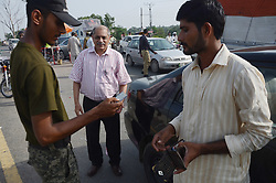 August 10, 2017 - Lahore, Punjab, Pakistan - Pakistani ranger officials personnel checks the vehicle at the city's entry point in Lahore. Ousted Prime Minister Nawaz Sharif left Punjab House Islamabad for his residence in Lahore,Pakistani Supreme Court has disqualified Sharif on July 28, after a probe into Sharif family's wealth following the 2015 Panama Papers dump linking Mr Sharif's children to offshore companies. (Credit Image: © Rana Sajid Hussain/Pacific Press via ZUMA Wire)