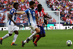 MADRID, May 7, 2018  Atletico Madrid's Arona Sane (R) vies with RCD Espanyol's Didac Villa (C) during a Spanish league match between Atletico Madrid and RCD Espanyol in Madrid, Spain, on May 6, 2018. Atletico Madrid lost 0-2. (Credit Image: © Edward Peters Lopez/Xinhua via ZUMA Wire)
