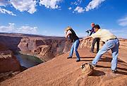 Photographers near the edge of a several thousand foot drop off near Glencanyon Dam.