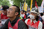 Student activists with Zengakren (All Japan Federation of Students' Autonomous Body)gather and campaign in Yoyogi Park during a protest rally organised by left wing group Doro Chiba. Tokyo, Japan June 14th 2009