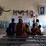 In the village of Saraf, the locals gather at a local church early morning. Their village was bombed earlier that morning.