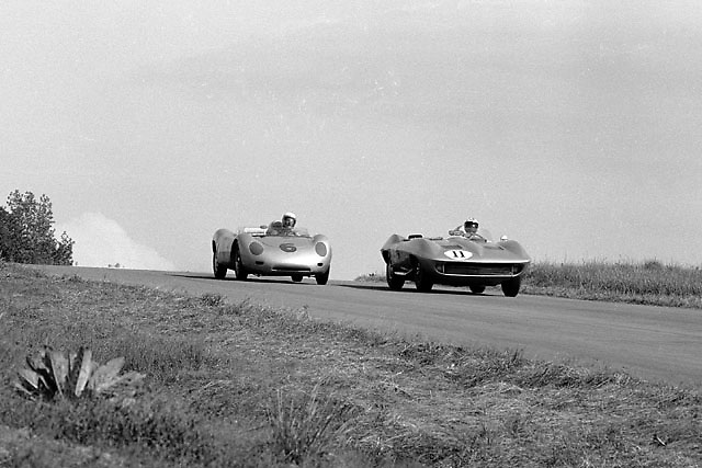 Roger Penske, Porsche 6, battling with Dr. Dick Thompson in Chevy Stingray before Thompson fell back with heat exhaustion; Ozzie Lyons photo