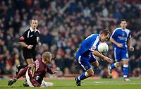 Photo: Daniel Hambury.<br />Arsenal v Cardiff City. The FA Cup. 07/01/2006.<br />Arsenal's Philippe Sanderos (L) fouls Cardiff's Rhys Weston.