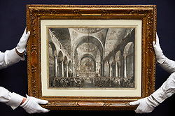 "© Licensed to London News Pictures. 28/06/2019. LONDON, UK. Technicians present ""The Presentation of the Doge in San Marco"" by Giovanni Antonio Canal (Canaletto) (Est. GBP1.5-2m) at the preview of Sotheby's Old Masters sale which takes place at its New Bond Street galleries on 3 July.  Photo credit: Stephen Chung/LNP"