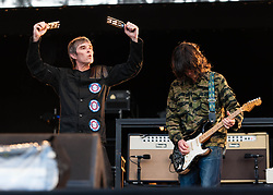 "© Licensed to London News Pictures. 07/06/2013. London, UK.   Ian Brown (left) and John Squire (right) of The Stone Roses performing live at Finsbury Park. The Stone Roses are an English rock band formed in Manchester in 1983, consisting of vocalist Ian Brown, guitarist John Squire, bassist Gary ""Mani"" Mounfield, and drummer Alan ""Reni"" Wren. They were one of the pioneering groups of the Madchester movement that was active during the late 1980s and early 1990s.   Photo credit : Richard Isaac/LNP"