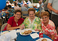 Maddy Dauphinais, Brenda Baer and Estelle Lyons enjoy brisket and pastrami sandwiches with knishes and blitzes for dessert at the annual Temple B'nai Isreal Jewish Food Festival on Sunday.  (Karen Bobotas/for the Laconia Daily Sun)