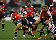 Danie Poolman puts in a tackle on Elton Jantjies during the Super Rugby (Super 15) fixture between the DHL Stormers and the Lions held at DHL Newlands Stadium in Cape Town, South Africa on 26 February 2011. Photo by Jacques Rossouw/SPORTZPICS